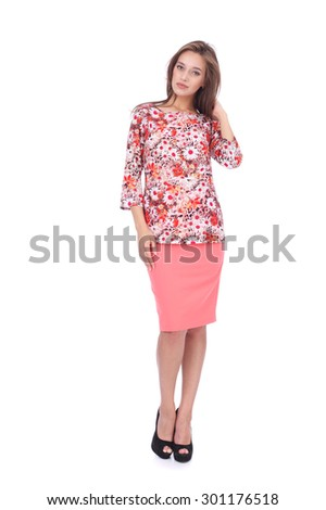 pretty young girl wearing coral short skirt and floral printed top - stock photo