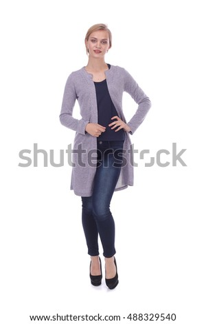 pretty young girl wearing jeans and cardigan