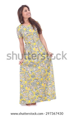 pretty young girl wearing long yellow dress - stock photo