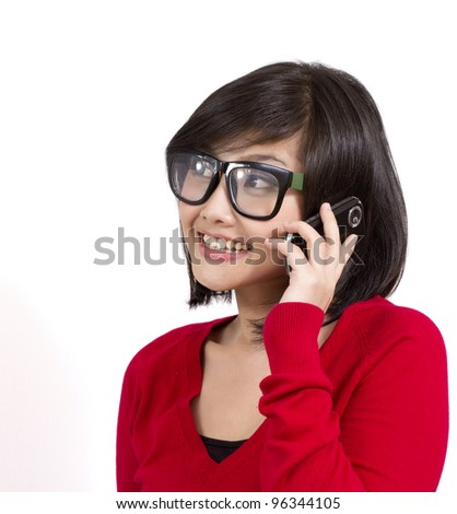 pretty young girl wearing nerd glasses talking on the phone - stock photo