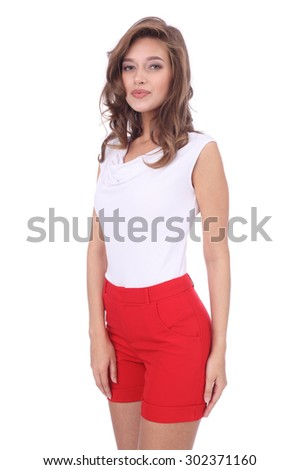 pretty young girl wearing red shorts - stock photo