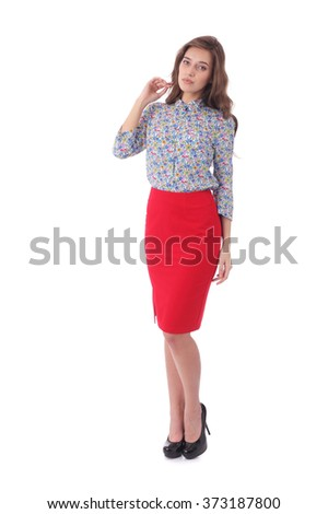 pretty young girl wearing red skirt and floral print blouse - stock photo