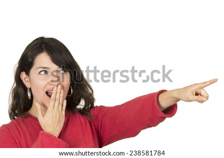 pretty young girl wearing red top pointing with finger looking surprised isolated on white - stock photo