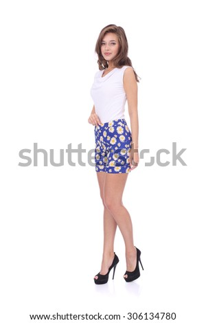 pretty young girl wearing shorts and top