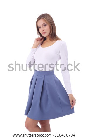 pretty young girl wearing white top and blue skirt - stock photo
