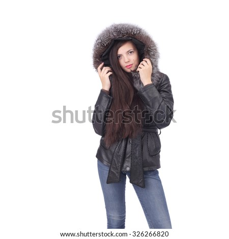 pretty young girl wearing winter clothing - stock photo