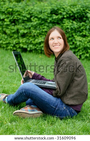 Pretty young girl with a laptop