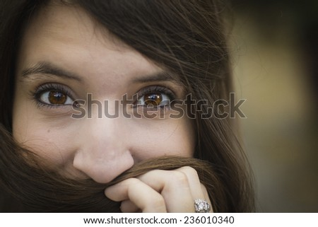 Pretty young girl with brown eyes looking into the camera.  - stock photo