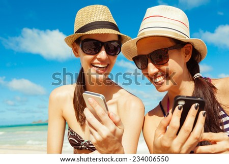 Pretty young girls having fun with smart phones - stock photo