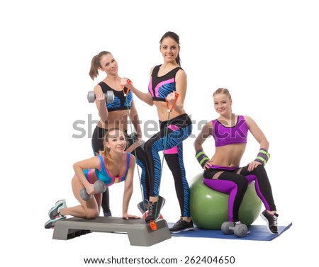Pretty young girls posing with sports equipment - stock photo
