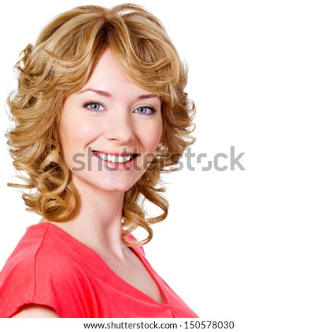 Pretty young happy woman with cheerful toothy smile - isolated on white - stock photo