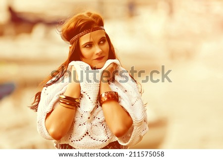 Pretty young hippie caucasian girl in motley boho fashion style outfit - stock photo