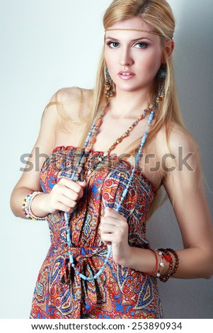 Pretty young hippie caucasian girl in motley boho fashion style outfit