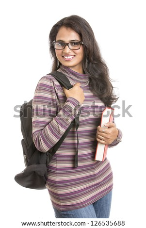 Pretty young Indian girl student posing with books on white. - stock photo