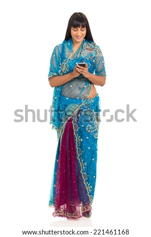 pretty young indian woman using smart phone on white background - stock photo