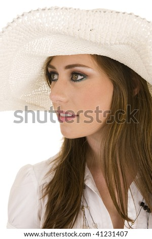 Pretty young lady in the studio wearing a wide-brimmed sun hat. Studio on white isolated background.