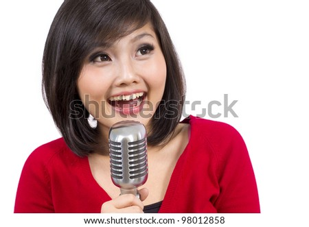 Pretty Young Lady Singing Using Vintage Microphone - stock photo