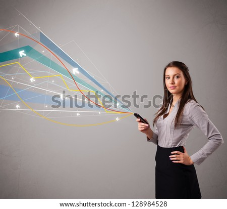 pretty young lady standing and holding a phone with colorful abstract lines and arrows - stock photo