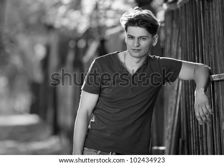 Pretty young man posing , outside shot