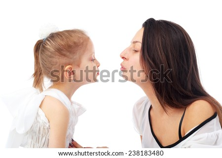 pretty young mother embracing her cute little daughter - stock photo