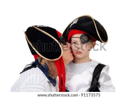 pretty young mother kissing her cute little kid, both in the pirate costumes - stock photo