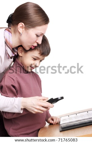 pretty young mother teaching her child to use the magnifying glass