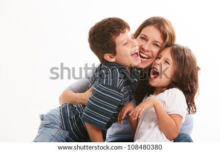 Pretty young mother with son and daughter in a fun pose isolated on a white background. - stock photo