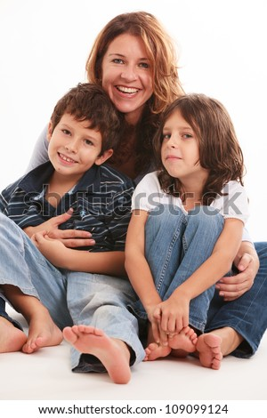 Pretty young mother with son and daughter isolated on a white background.