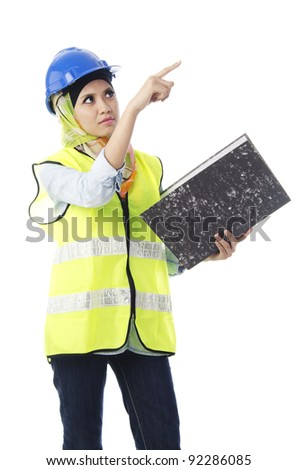 Pretty young Muslim woman in working show an above with hand in action. - stock photo