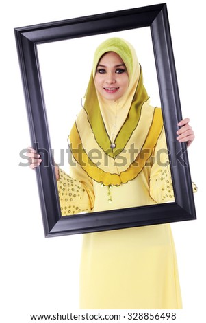Pretty young Muslim woman pose with holding a frame