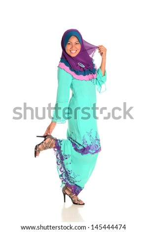 Pretty young muslimah in catwalk action on white background on white background - stock photo