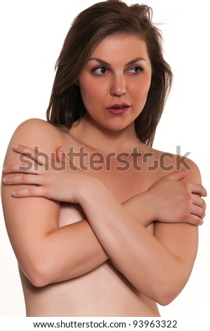 Pretty young nude brunette with arms crossed