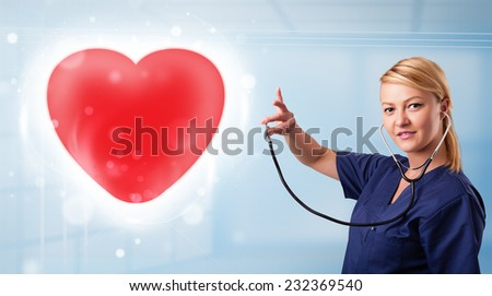 Pretty young nurse healing a red heart - stock photo