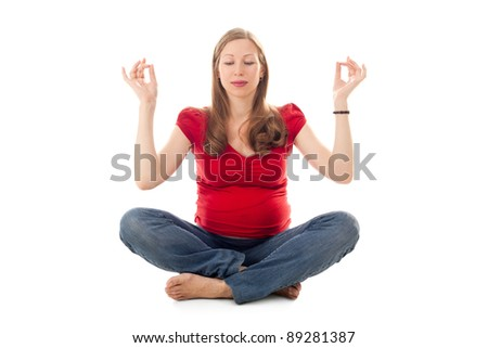 pretty young pregnant woman practicing yoga in studio - stock photo