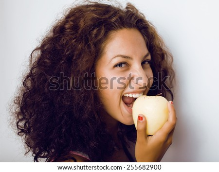 pretty young real tenage girl eating apple close up - stock photo