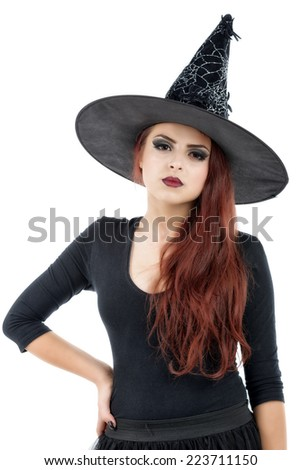 pretty young redhead witch, isolated against white background - stock photo