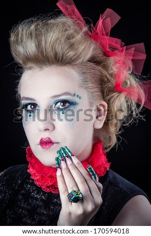 Pretty young ringmaster woman with a red hat and green nails