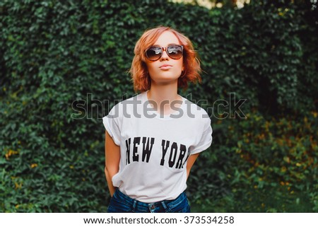 Pretty young sensual fashion woman posing outdoor vintage hipster style,cute,city ,woman,fancy, wart,glasses, color, hair, crop, elegant,autumn, amazing,teeth,holiday,cover,beauty,student, reading - stock photo
