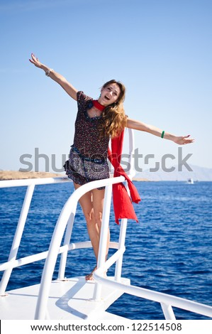 Pretty young slim  woman in  sailboat yacht on private speed-boat on vacation in summer time happy sailing in Mediterranean sea with red - stock photo
