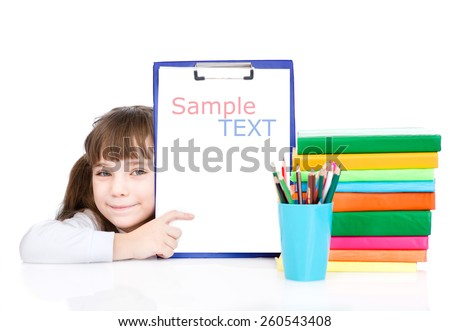Pretty young smart student pointing towards blank. isolated on white background