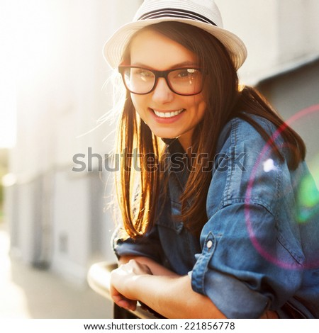 Pretty young smiling hipster fashion woman closeup made outdoor in summer on the street  - stock photo