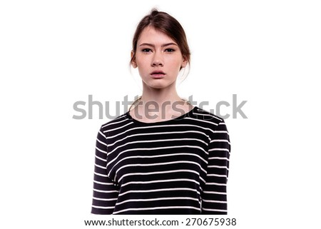 Pretty young teenager girl looking at camera innocently - stock photo