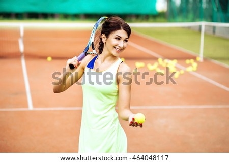 pretty young tennis player woman playing tennis. sexy Smiling girl athlete wearing yellow sportswear