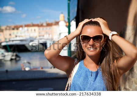 Pretty young tourist walking in the port, summer holidays in France - stock photo