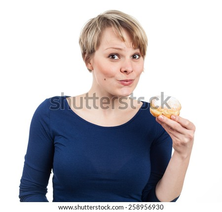 Pretty young woman about eating a donut, isolated on white - stock photo