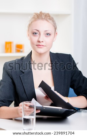 Pretty young woman at a job interview - studio shoot