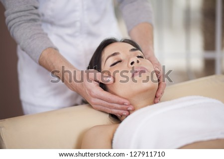 Pretty young woman being pampered at a spa - stock photo