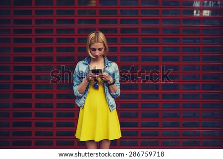 Pretty young woman chatting on smart phone against blank copy space bright background for your content or text message,female hipster student in the dress using mobile phone for connect to wireless - stock photo
