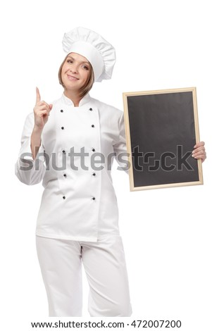 pretty young woman chef, cook or baker holding empty blackboard for your text and pointing up isolated on white background. restaurant, dieting and cooking food concept