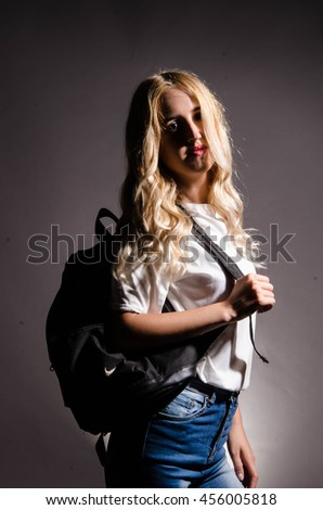 Pretty young woman college or high school student  - stock photo